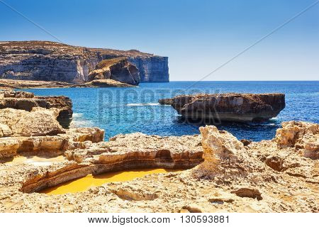 Fantastic views of rocky coast on a sunny day with blue sky. Picturesque and gorgeous scene. Location famous place Azure Window, Gozo island, Dwejra. Malta. Europe. Mediterranean sea. Beauty world.