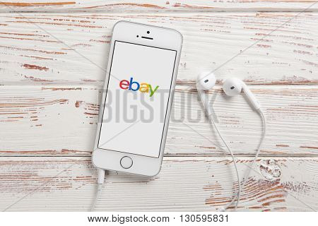 WROCLAW, POLAND - APRIL 12, 2016: Apple iPhone SE smartphone with eBay app on screen