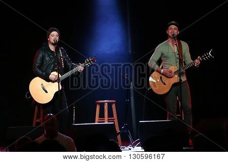 PATCHOGUE, NY-FEB 3: Musicians Stephen Barker Liles (L) and Eric Gunderson of Love and Theft perform onstage at The Emporium on February 3, 2016 in Patchogue, New York.