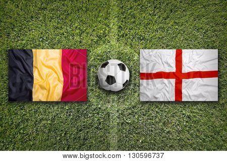 Belgium Vs. England Flags On Soccer Field