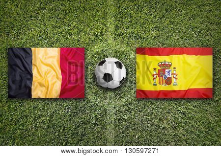 Belgium Vs. Spain Flags On Soccer Field