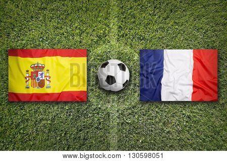 Spain Vs. France Flags On Soccer Field