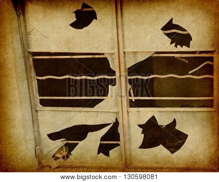 building with broken windows on Grunge Abstract Background