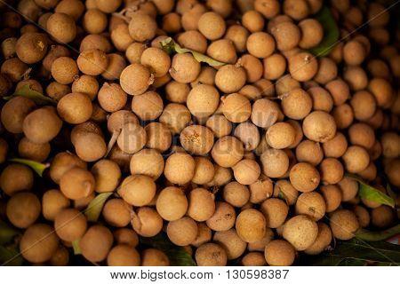 Fresh longan fruits. Traditional thai market closeup.