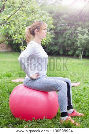 Girl Exercising On Fitness Ball