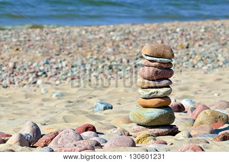 Pyramid of colored pebbles on a Sunny beach