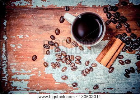 Fragrant Coffee On A Wooden Background, Espresso Cup And Saucer