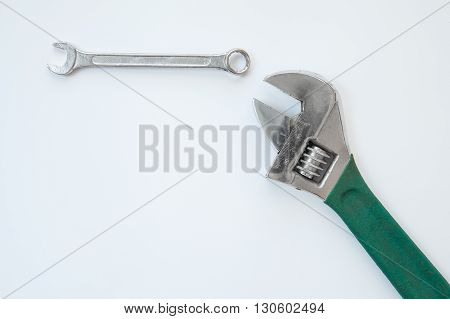 spanner and wrench with green grip on white background
