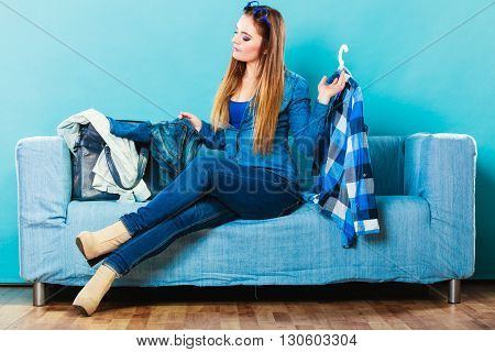 Fashionable Woman With Plaid Shirt On Couch