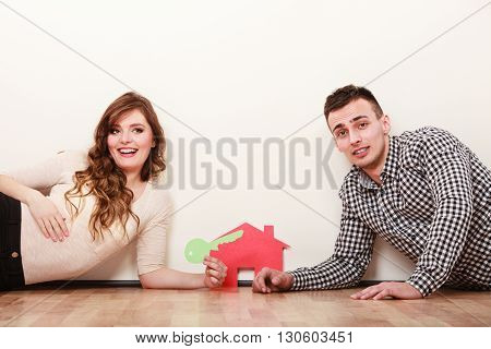 Couple With Paper House. Housing Real Estate.