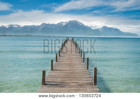Summer Travel Vacation and Holiday concept - Wooden pier in lake at Switzerland