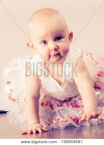 Lovely little child girl in princess fairy dress. Portrait of cute beauty sweet baby ballerina.