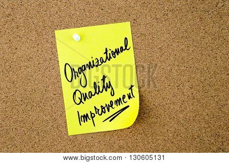 Organizational Quality Improvement Written On Yellow Paper Note