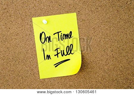 On Time In Full Written On Yellow Paper Note