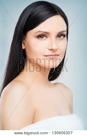 Headshot of beautiful brunette girl on grey background