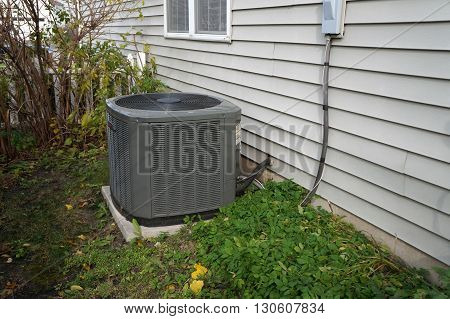 JOLIET, ILLINOIS / UNITED STATES - NOVEMBER 5, 2015: An air conditioner cools a home in the Wesmere Country Club neighborhood of Joliet.