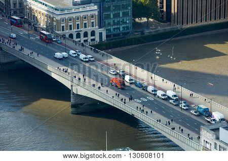 LONDON, UK - OCTOBER 14, 2015. London panorama, London bridge, transport and people walking across the bridge