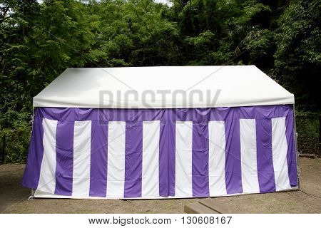 large white tent for event in a public park