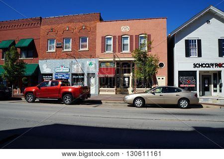 PLAINFIELD, ILLINOIS / UNITED STATES - SEPTEMBER 20, 2015: One may purchase works of art in the Lockport Street Gallery, and ice cream at the Gourmet Junction, in downtown Plainfield.