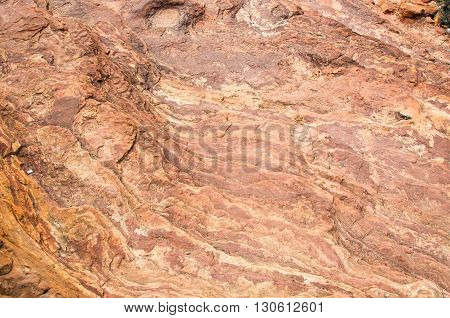 Background texture of red and white banded tumblagooda sandstone rock from Kalbarri National Park in Kalbarri, Western Australia.
