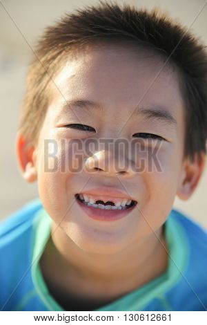 caucasian boy losing front teeth happy smile