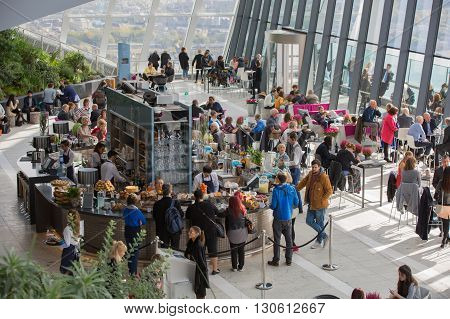 LONDON, UK - OCTOBER 14, 2015 - People by the Sky Garden bar ordering coffee, snacks and refreshments