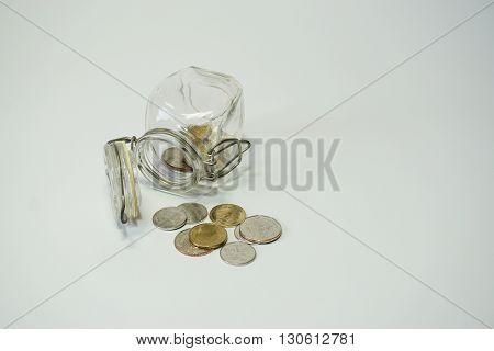 Savings money bottle coins thai baht isolated on white background