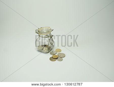 Small money bottle coins thai baht on white background