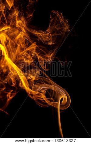 Abstract art. Color yellow smoke from the aromatic sticks on a black background. Background for Halloween. Texture fog. Design element. The concept of aromatherapy.
