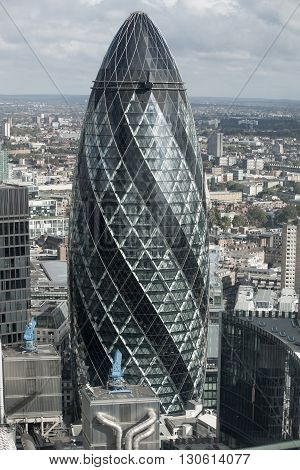 LONDON, UK - OCTOBER 14, 2015; Gherkin building Modern office blocks City of London, business and banking aria.