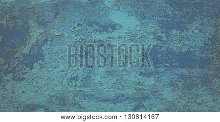 Old weathered paint on a concrete wall. Blue abstract background.
