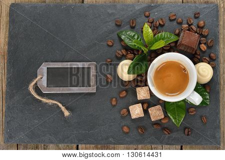 Cup of espresso and chocolate on a black background