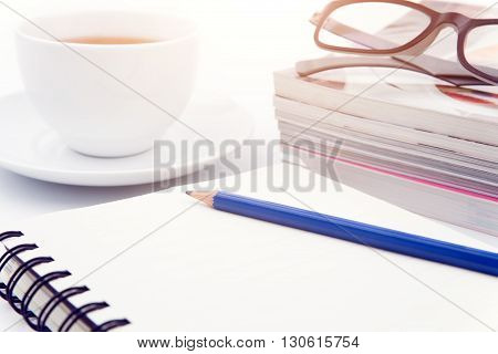 Cup of coffee on with book and Pencil on white background