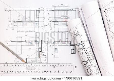 Architect Workspace With Blueprints, Pencil And Ruler