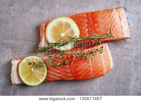 Two Fresh Raw Salmon Fillet With Lime, Lemon And Spices