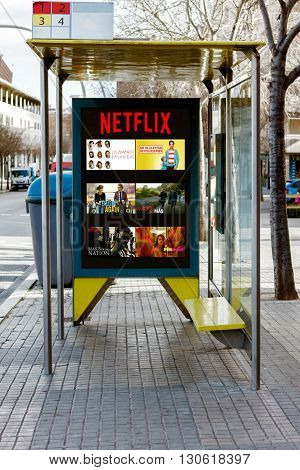 BARCELONA SPAIN 13 JANUARY 2016: Netflix publicity at Billboard on bus stop Netflix is a provider on-demand streaming media
