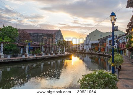 View of river house and riverwalk with sunrise in Malacca Malaysia.