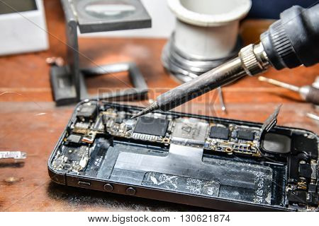 Repairing mobile phone with the soldering iron