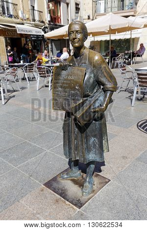 Caceres Spain - March 16 2016: The statue of the popular selling Leoncia Gomez Galan Extremadura the last town crier of Extremadura newspaper.