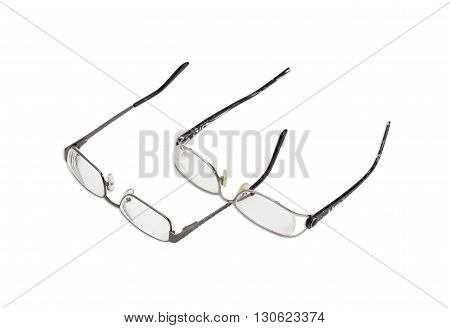 Two modern pairs of women's eyeglasses with single vision lenses and metal frame on a light background