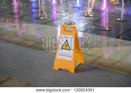 Yellow of Caution wet floor sign is on the wet floor