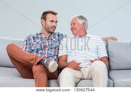 Father and son interacting with each other in living room