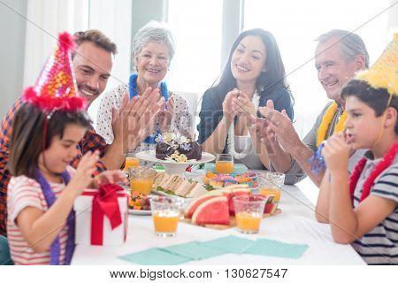 Happy family celebrating a birthday at home