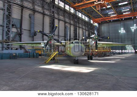 Kiev Ukraine - August 3 2011: Antonov An-32 cargo plane being final assembled at the aircraft manufacturing hangar