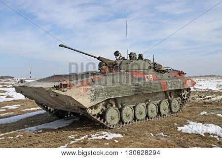 Zhitomir Ukraine - March 10 2011: Armored personnel carrier BMP-2 during the military trainings in the field