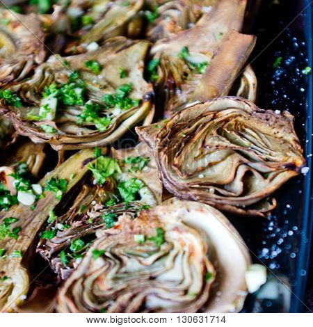 artichokes baked in oven seasoned only with extra  olive oil parsley and lemon are a healthy and purifying food to stay fit during the summer