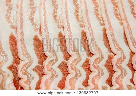 slices of pork bacon rashers laid against each other