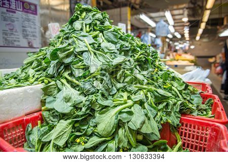 Pile of dark green leaves of choi sum at market in Hong Kong