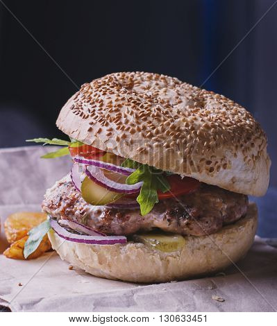 food - a hamburger with blue onion,pickle, fries