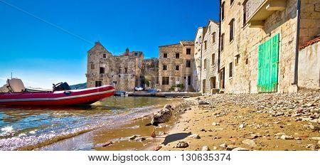 Stone houses on Komiza beach Island of Vis Croatia